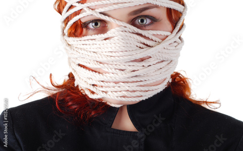 portrait of a woman with rope on her face