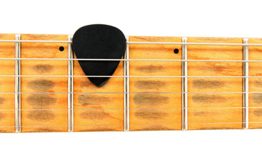 Shabby electric guitar neck with black mediator.