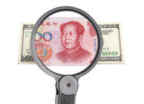 Magnifying glass, dollar and Chinese yuan poster