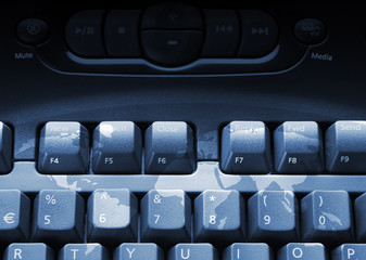 Media computer keyboard overlaid with world map