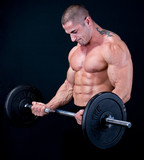Man with a bar weights in hands training - 10324900