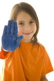 young girl with stop hand painted in blue isolated on white