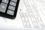Calculator with invoice, close up poster