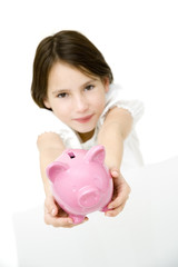 young girl with piggy bank isolated on white
