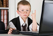 Four year old boy playing angry boss in his office