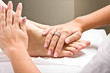 Woman's hands giving a healthy foot massage
