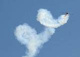 Aerobatic airplane performing stunt act poster