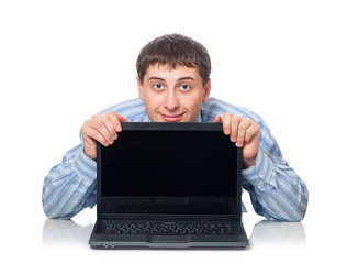 young adult man behind the laptop, isaolated on white background