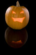 Jack-o-Lantern on a reflective surface