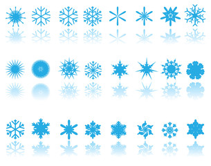 blue snowflakes on white background with reflection