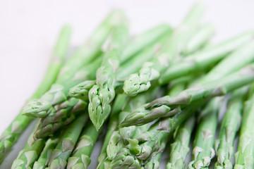 Fresh asparagus on white ground