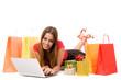 Beautiful shopping girl shopping over internet.
