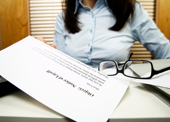 Young caucasian businesswoman received the notice of layoff
