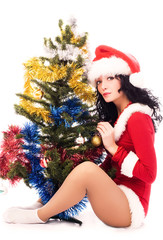 sexy brunette woman decorating a Christmas tree