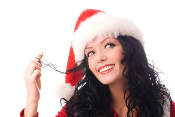 portrait of a coquettish sexy brunette woman wearing Santa's hat
