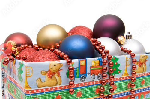 christmas decoration. colorful balls in the wrapped box