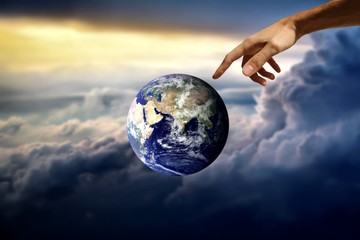 earth and hand