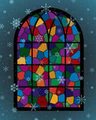 window with colorful glass mosaic and snowflakes