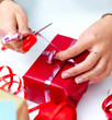 Womans hands wrapping a christmas present