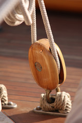 Wooden pulley in a ship.