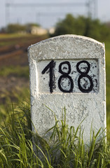 Old milestone in the grass