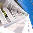Blue glass corridor in office centre