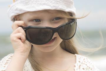 Little girl and big sunglasses
