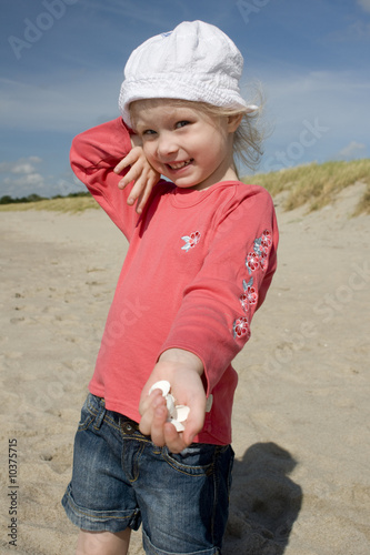 Cheerful little girl with cockleshell