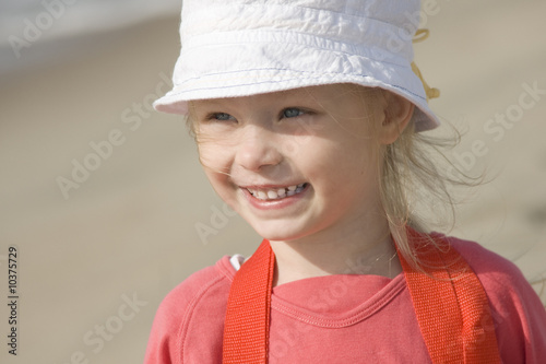 Smiling cheerful girl on the seacoast