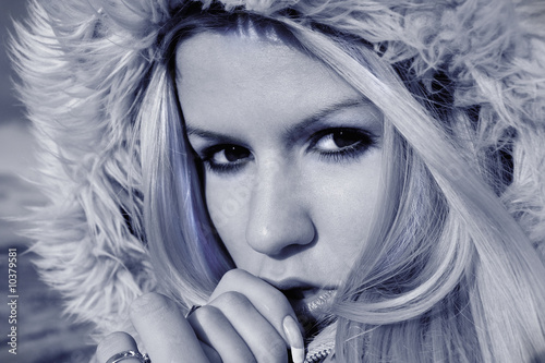 Fascinating winter portrait of young blonde in a hood