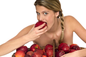 Attractive naked model tasting a juicy apple on white background
