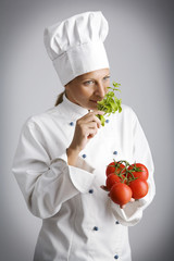 female chef  with fresh, natural ingredients