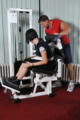 Young woman doing fitness sport in gym