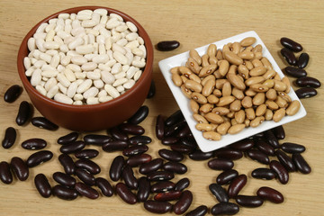 Three sorts of beans in ceramic bowls. Cuisine composition.