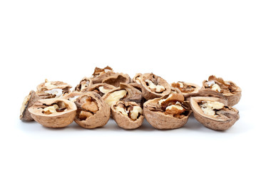 Cracked walnuts isolated on the white background