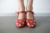 Fototapety close-up of feet in red shoes with white dots