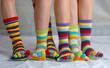 Many colored socks. closeup image of six legs
