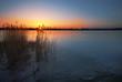 Frozen lake at sunset