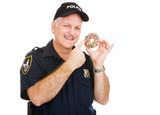Policeman pointing to a delicious sprinkle covered donut. poster