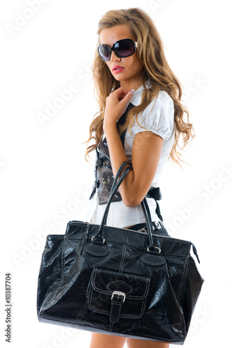 Fashion model with big bag. Isolated on white