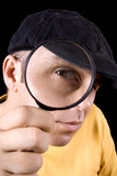 Investigator looking through magnifying glass poster