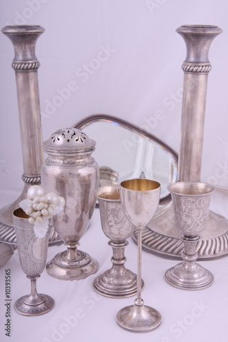 Various antique silver objects in studio light