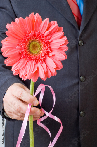 man holding flower