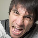 Enraged young man poster