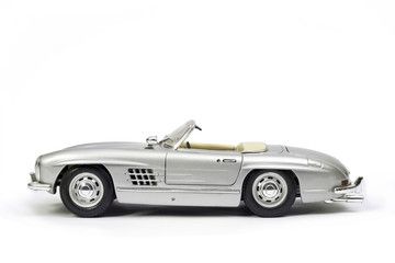 Classical sport car model toy. Side view.