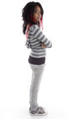 side pose of punk teenager on an isolated white background