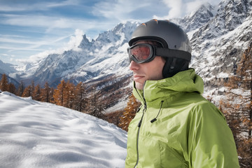 Portrait of young skier with ski goggles and helmet.