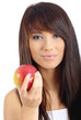 Beautiful young woman eating a red apple. Isolated over white