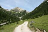 Gravel road in Alpine valley. Lechtal Alps in Tirol, Austria.