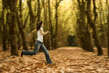 Woman runing in the Autumn Park -  Intentional blured efect poster